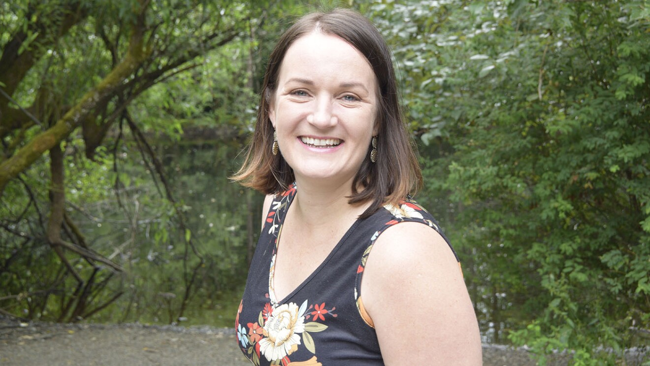 A photo of JoAnna Hunt, Principal Project Manager leading the Kindle Accessibility Team and Director of A11yCon.
