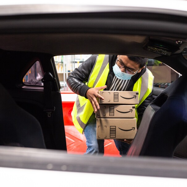 An Amazon Flex delivery partner loads his car with packages in Sydney