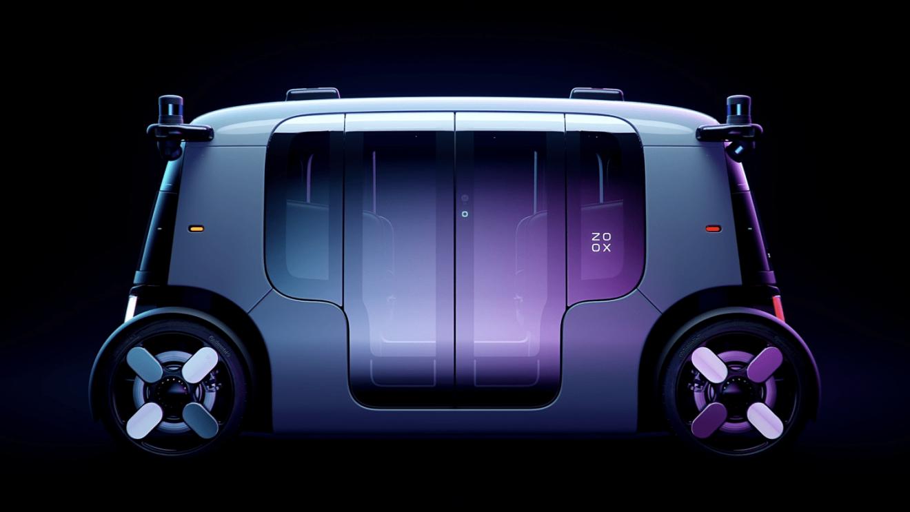 Side view of a Zoox autonomous robotaxi against a black background