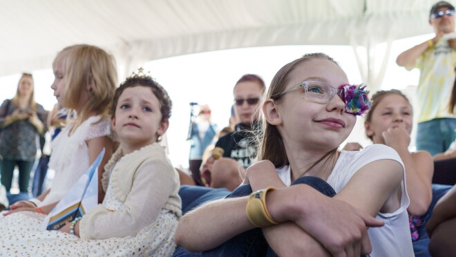 Children at an Amazon event in support of Childhood Cancer Awareness Month. Many of the children are wearing gold, in honor of the event.