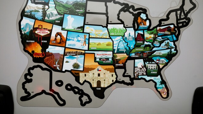 An outline map of the United States. Most states are filled in with stickers.