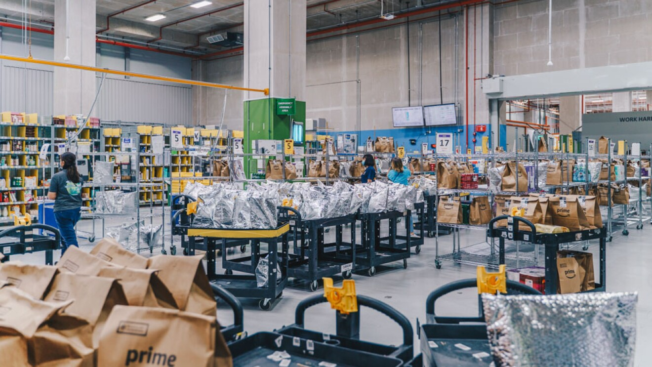 The Magic Library at the Amazon Fresh fulfillment centre filled with packages ready for pick up by delivery drivers