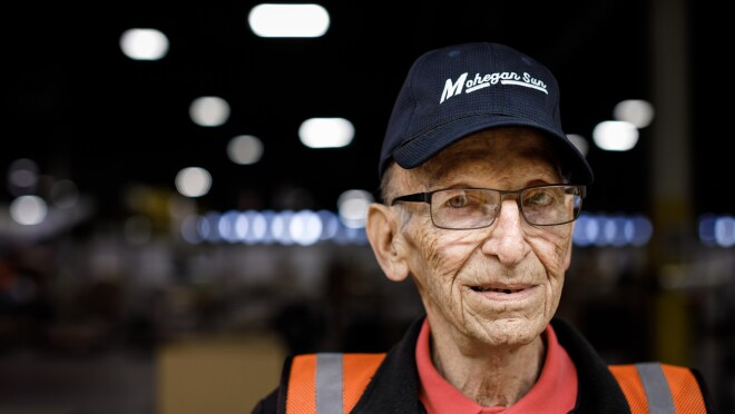 Amazon employee Rick Reefer. He is wearing glasses, a cap that says 'Mohegan Sun', and is looking into the camera.