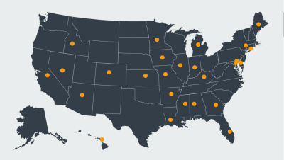 An image of a blue map of the US with orange dots pinpointing certain areas.