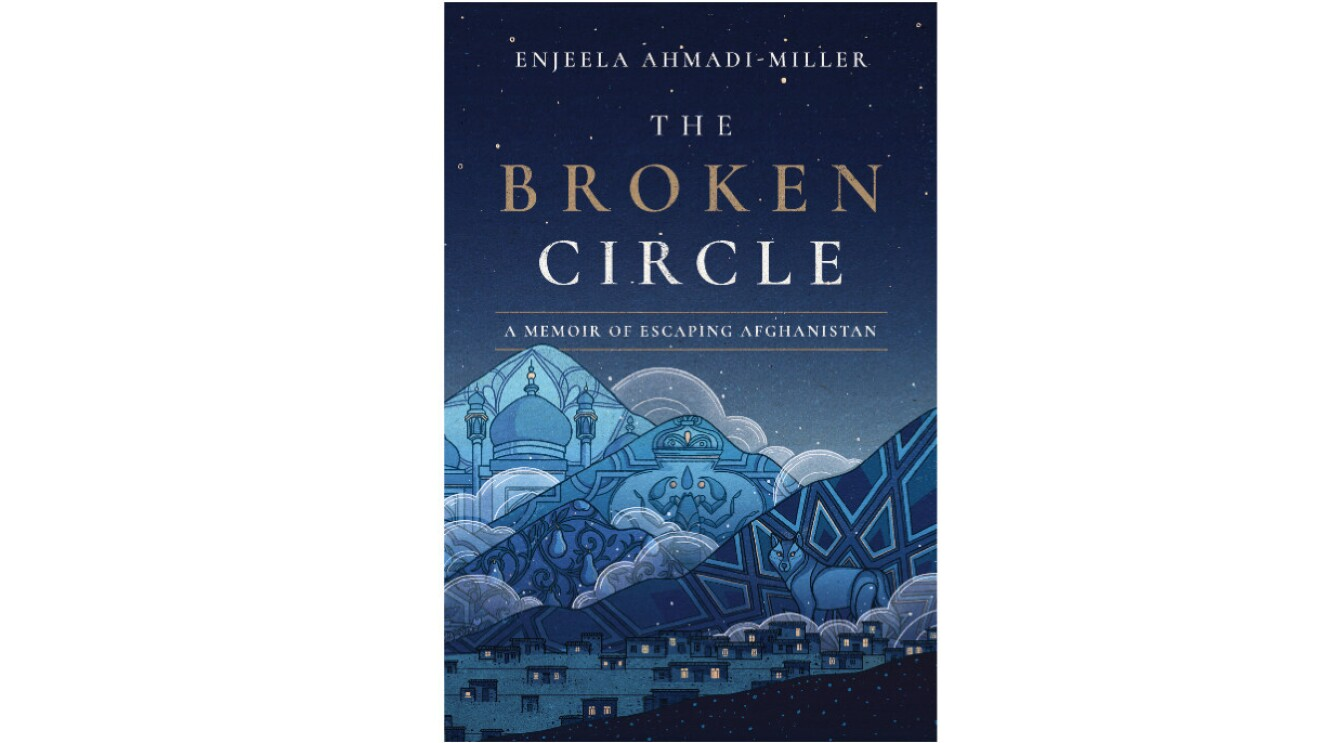 """The book cover of """"The Broken Circle"""" consists of shades of blue mountains in a night sky. Within one mountain appears a palace, in another mountain appears a scorpion and in the third mountain are line patterns with a wolf. A town sits at the base of the mountains."""