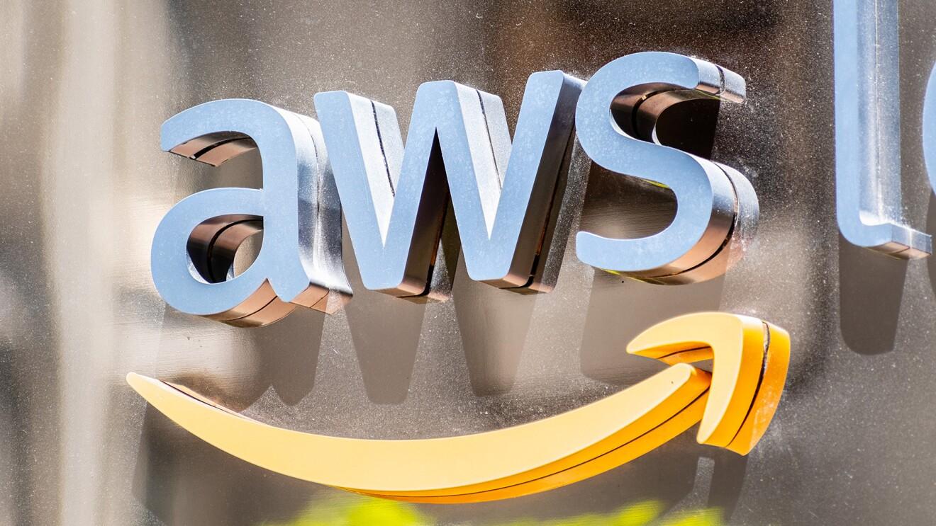 AWS logo in metallic finish on a metallic wall