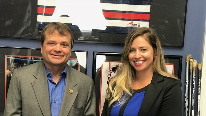 Two adults, standing side-by-side. Rep. Mike Quigley (D - Illinois) and Amazon seller, Kristin Rae.