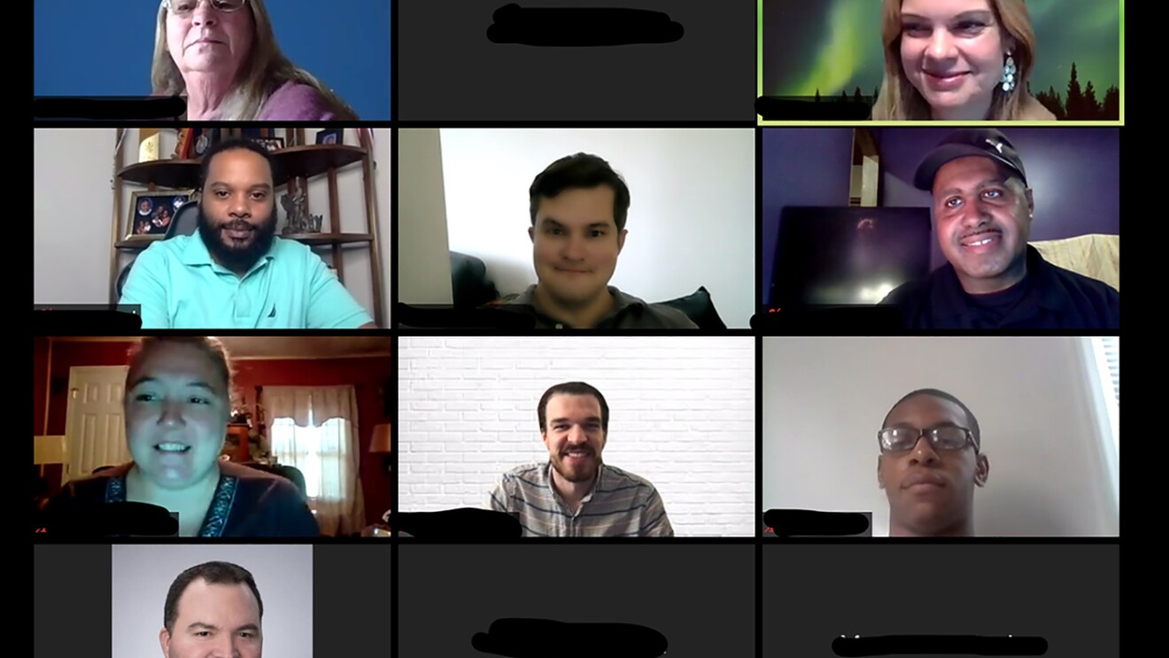 A Zoom call, showing more than a dozen individuals participating in AWS re/Start cloud education.