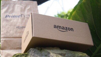 An Amazon package and Prime Now package are placed on a rock in the Spheres.