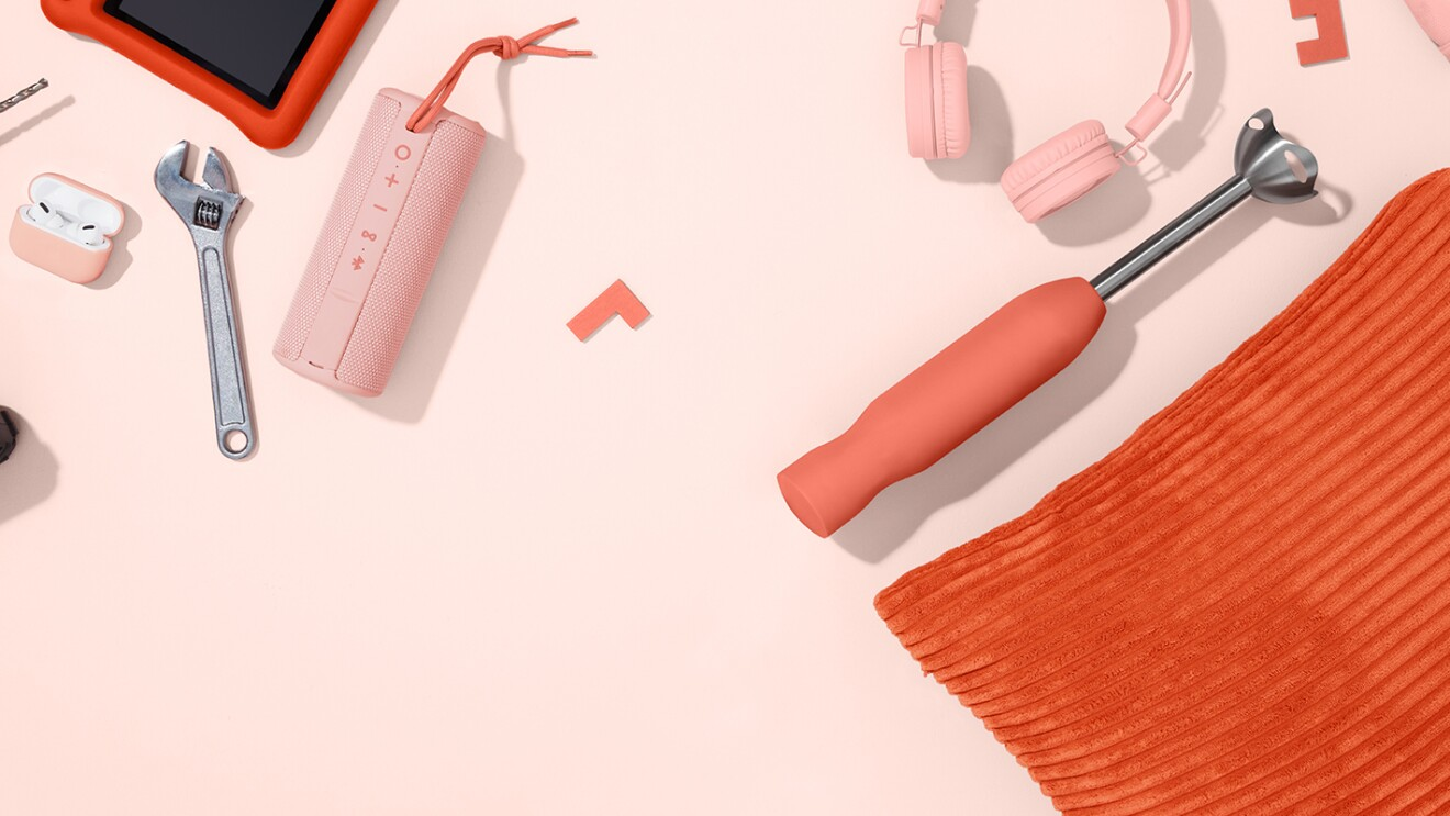 An image with a pink background that features products from Amazon like a drill, a bluetooth speaker, headphones, and other electronics, decor, apparel, and kitchen appliances.