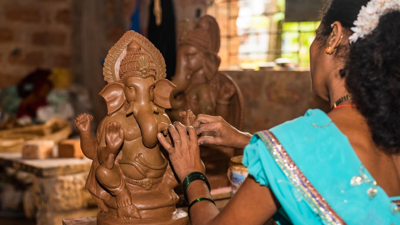 A lady making an eco friendly Ganesha