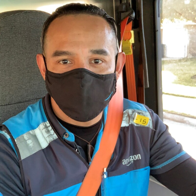 Amazon Delivery Service Provider (DSP) in their work vehicle, wearing an Amazon vest