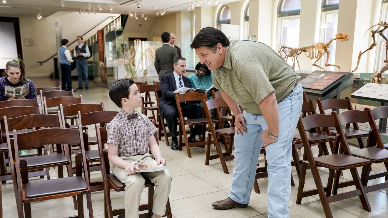 Young Sheldon with his dad