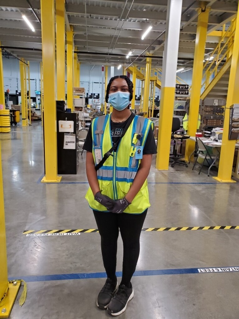 Amazon employees who work on the middle mile, posing for the camera at work