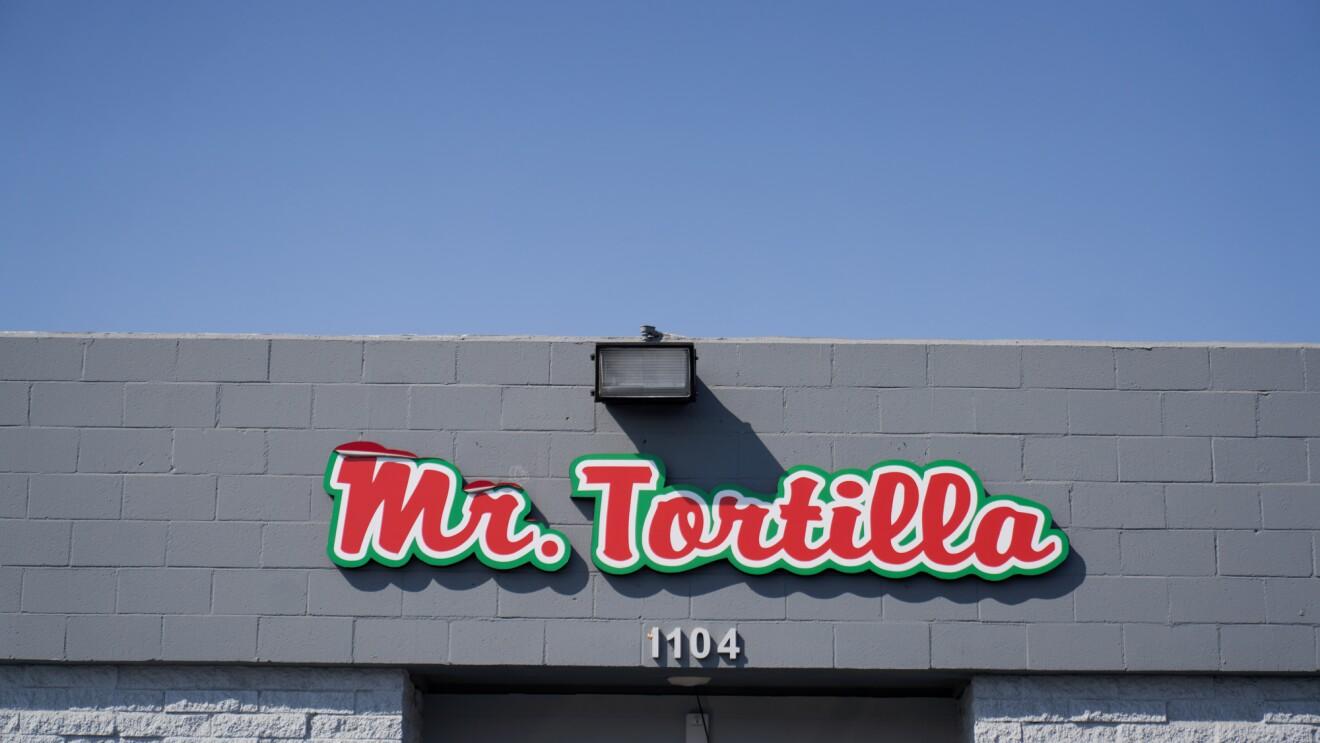 A Mr. Tortilla sign hangs above a warehouse door.