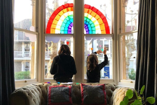 Rainbows displayed in windows, created by children, as a means to thank essential workers during the COVID-19 pandemic