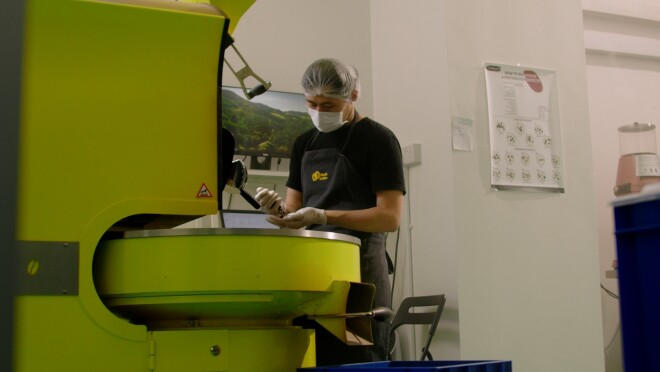 Head of Coffee, Goh Eng Kit, roasting beans at the roastery within Hook Coffee's premises