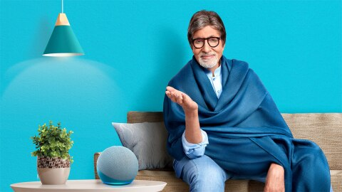 Amitabh Bachchan sitting on a sofa