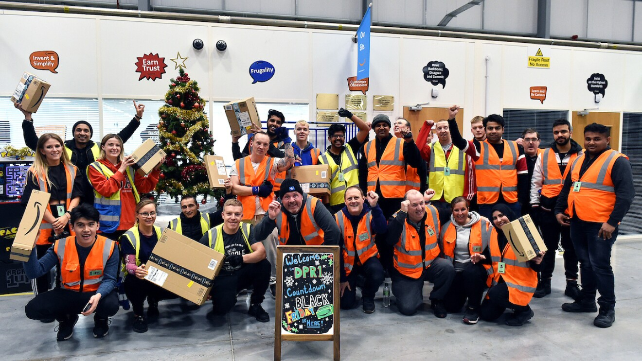More than a dozen Amazon associates get together for a group photo at the Leyland, UK fulfillment center