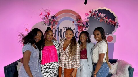 A group of five women pose togther in front of a backdrop on pink. Tiffany Johnson, program manager for small business empowerment; Maxine Gray, program manager for small business empowerment; Amazon Seller Danyel Surrency-Jones, co-founder and CEO of POWERHANDZ; Brandi Neloms, manager for small business PR; Angelina Howard, senior product manager for digital video games
