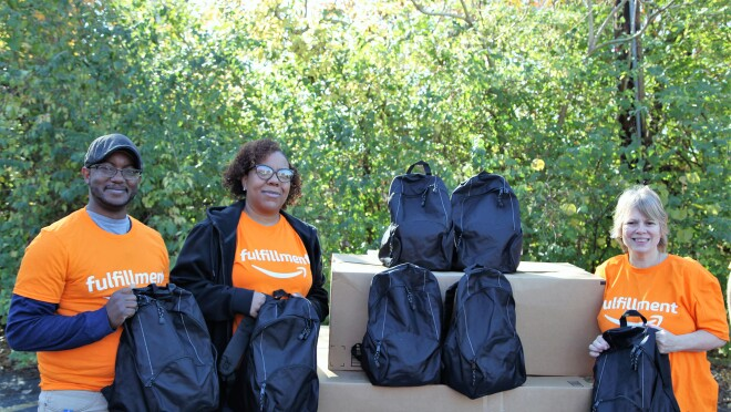 Amazon associates fill backpacks with essentials to support non-profits