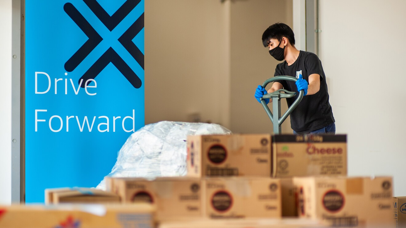 Amazon employees work together to gather and provide nonprofit donations for people in need.