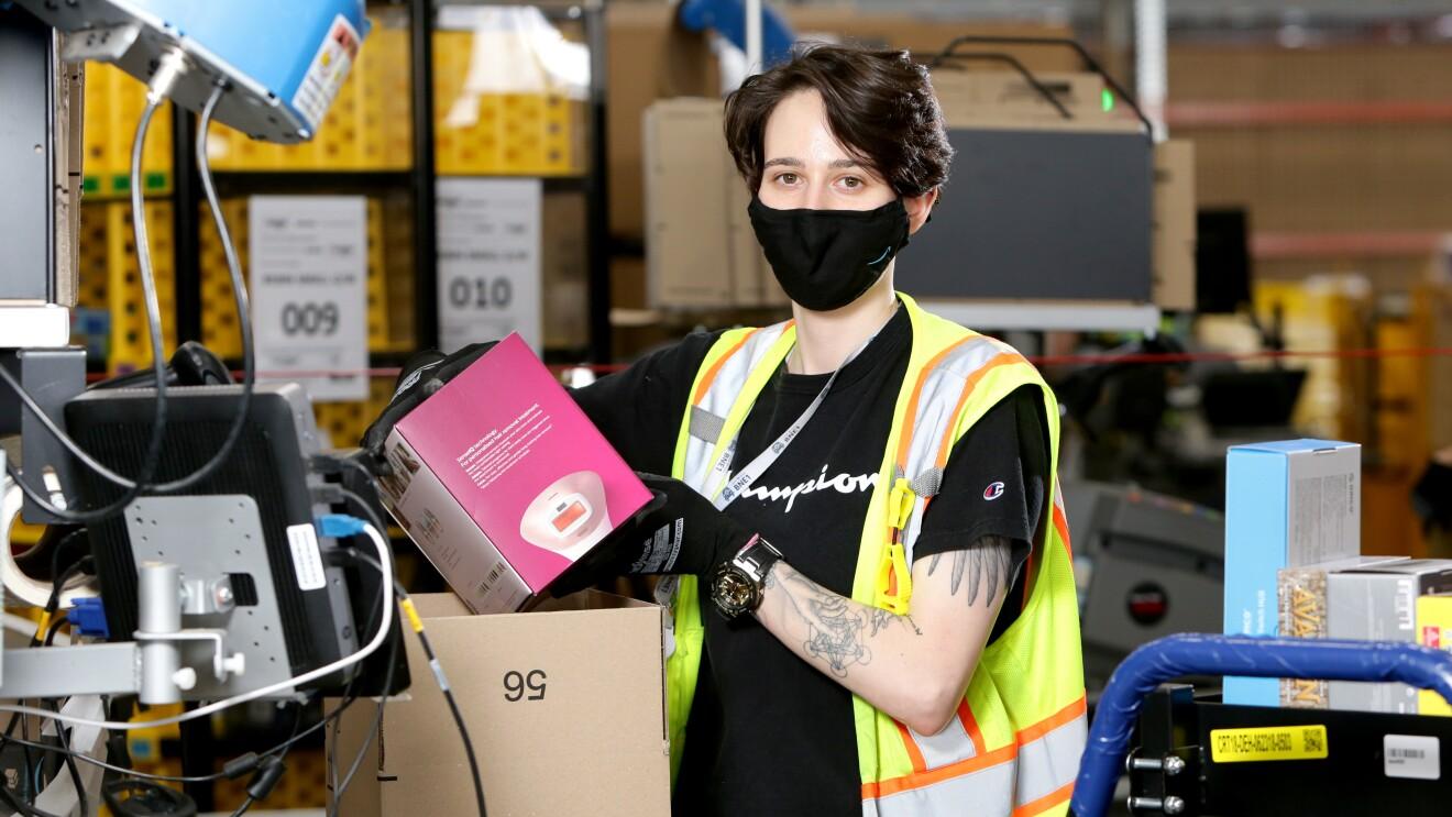 Amanda packs a box at Amazon's Brisbane fulfilment centre