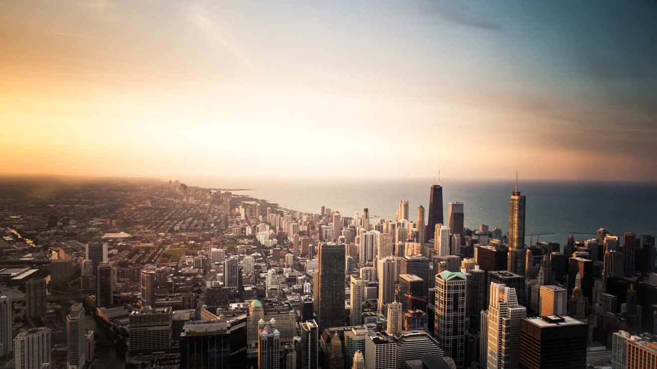 The Chicago Loop skyline with Lake Michigan and sunset background