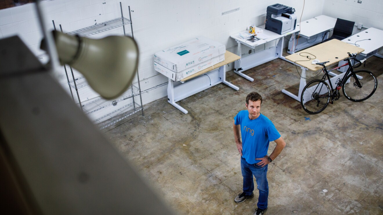 Jamie Siminoff, founder of Ring, stands in a workspace with concrete floors at Ring headquarters in Santa Monica, CA.