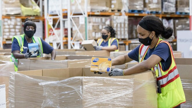 Person working with an Amazon Disaster Relief Hub prepares supplies for humanitarian and disaster relief efforts.