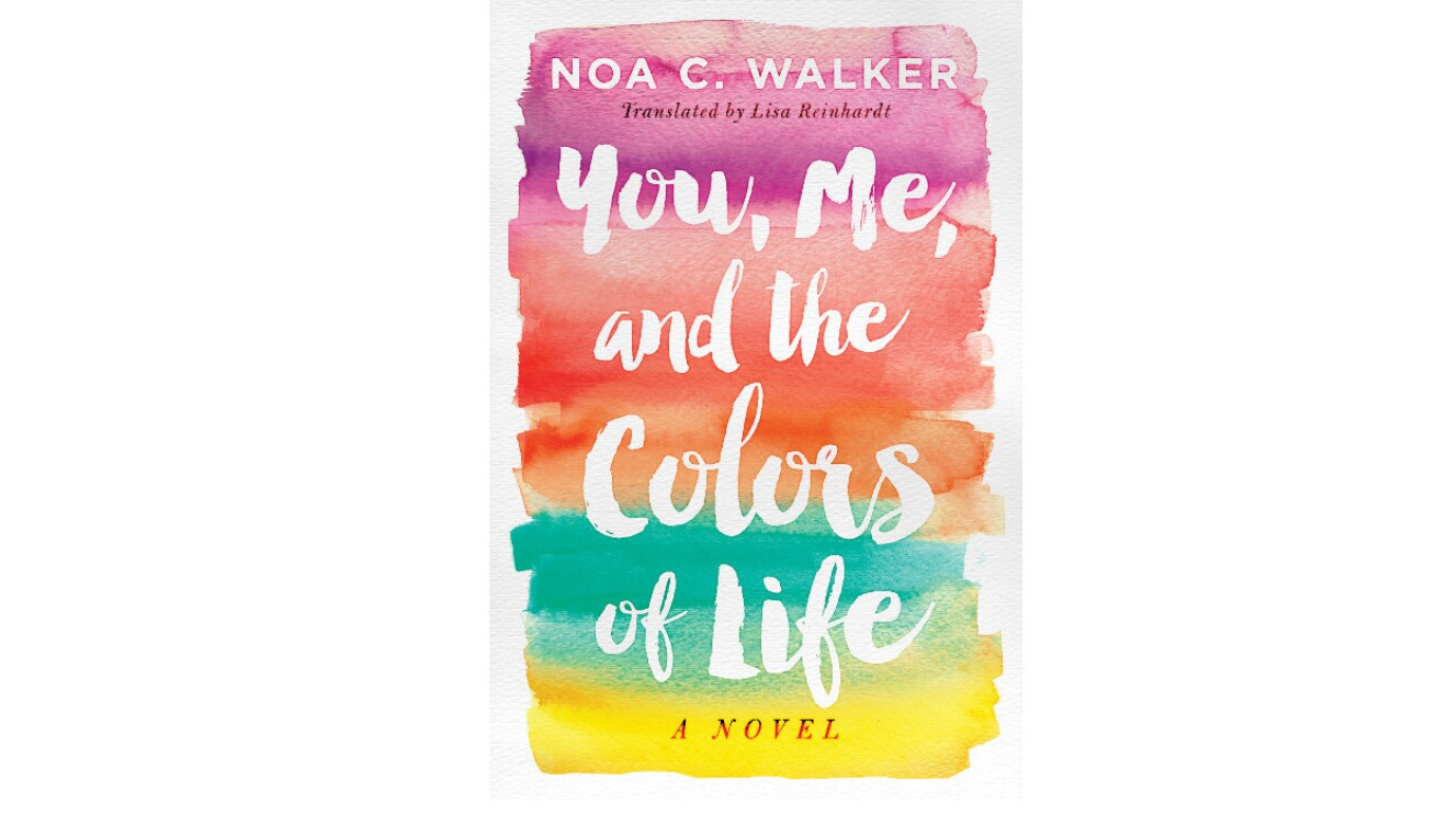 """The book cover of """"You, Me and the Colors of Life"""" is a colorful cover with title of the book in white. The colors appear to be waterpaint-like and from the bottom up go from yellow to teal to orange to coral to violet."""