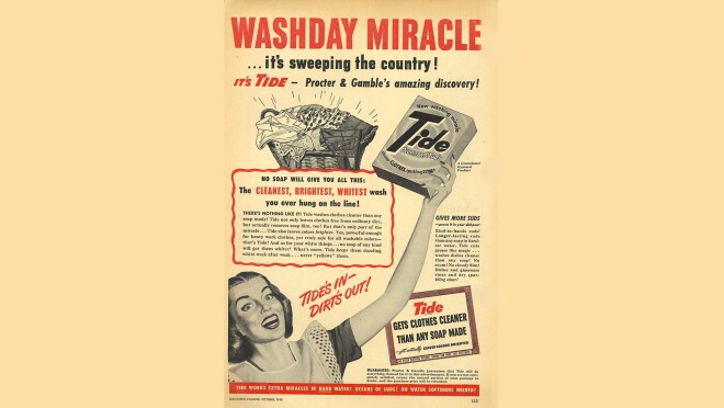 """Vintage print advertisement for Tide laundry detergent. The ad shows a woman holding a box of Tide aloft. The text at the top of the ad says """"washday miracle"""" in all-capital letters."""