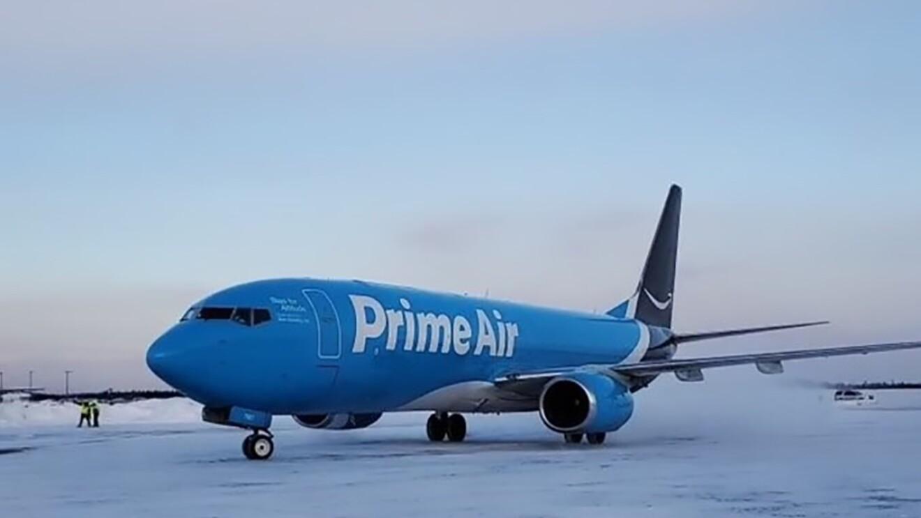 A Prime Air plane on a wintery tarmac in Alaska