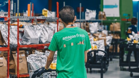 An employee packing an order at the Amazon Fresh Fullfilment Centre Singapore