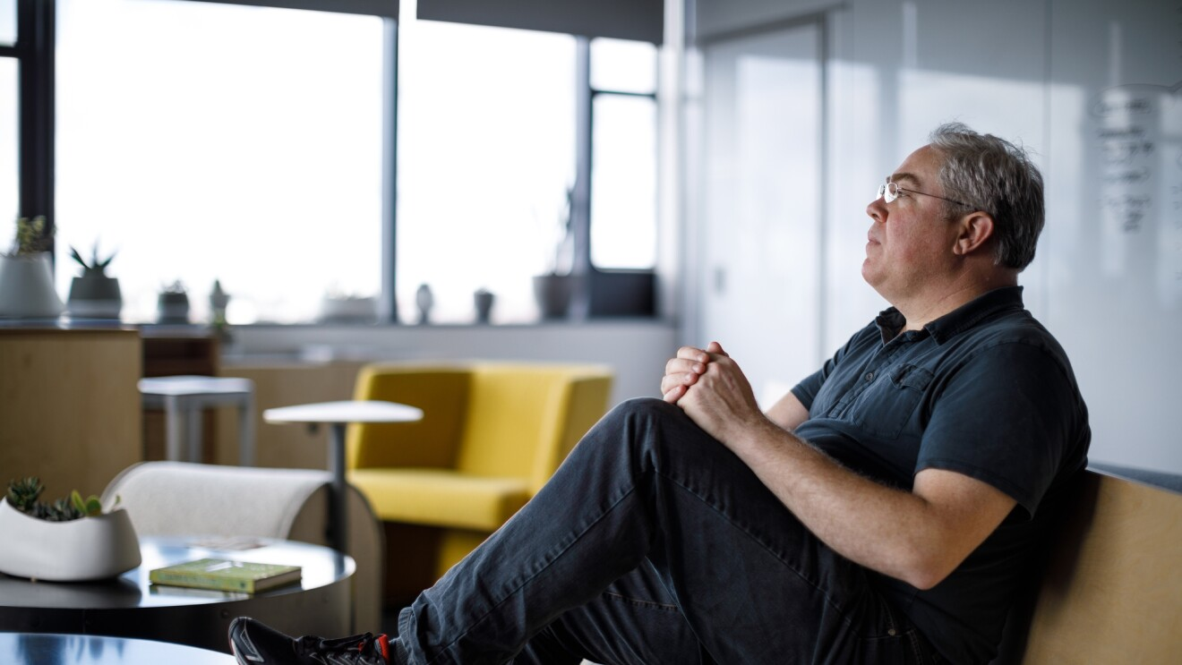 Profile photo of Amazon employee Brendan Gramer sitting on a couch looking to the left.