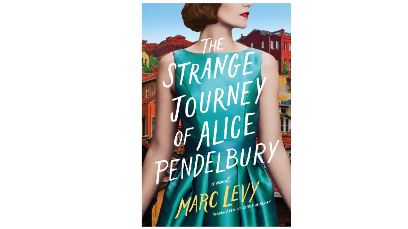 """The book cover of """"The Strange Journey of Alice Pendelbury"""" features a woman from the nose down to her hips wearing a sleeveless seafoam dress. The woman has short brown hair, wears red lipstick and her head is turned to her left. Behind the woman is a city with homes stacked on top of one another."""