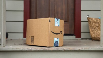 An Amazon package sits on a doorstep.