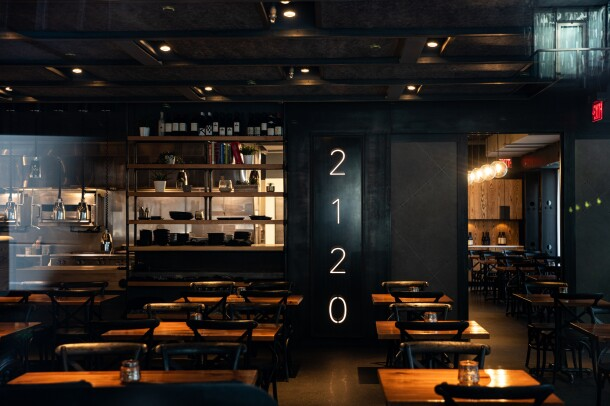 An empty restaurant with the number 2120 in the center of the space.