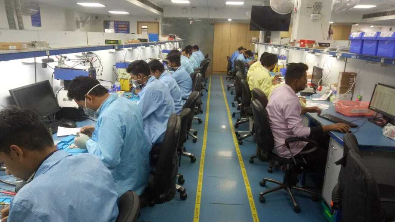 Technicians at work in the Yaantra lab working on refurbished phones