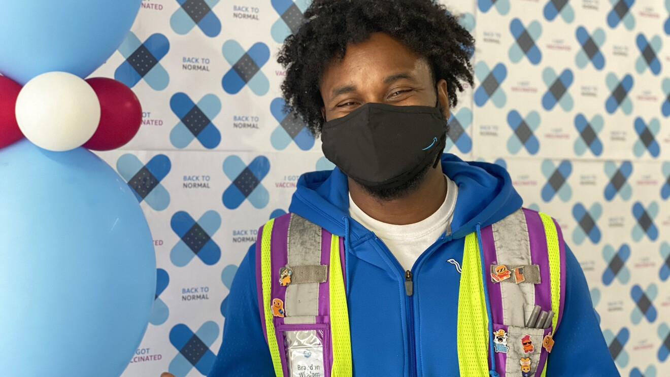 Amazon employee at a COVID-19 vaccination event