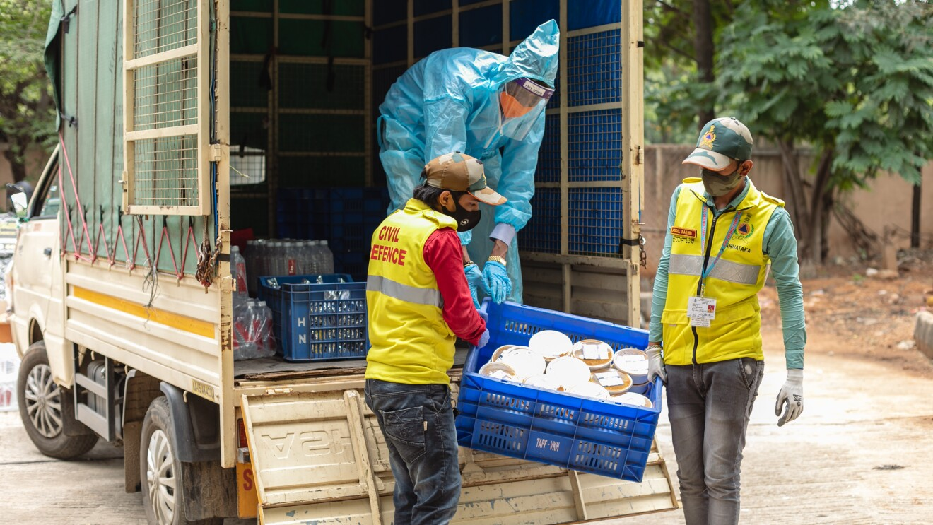 Workers unload essential rations for those in need as part of the Amazon and AkshayPatra meals program.