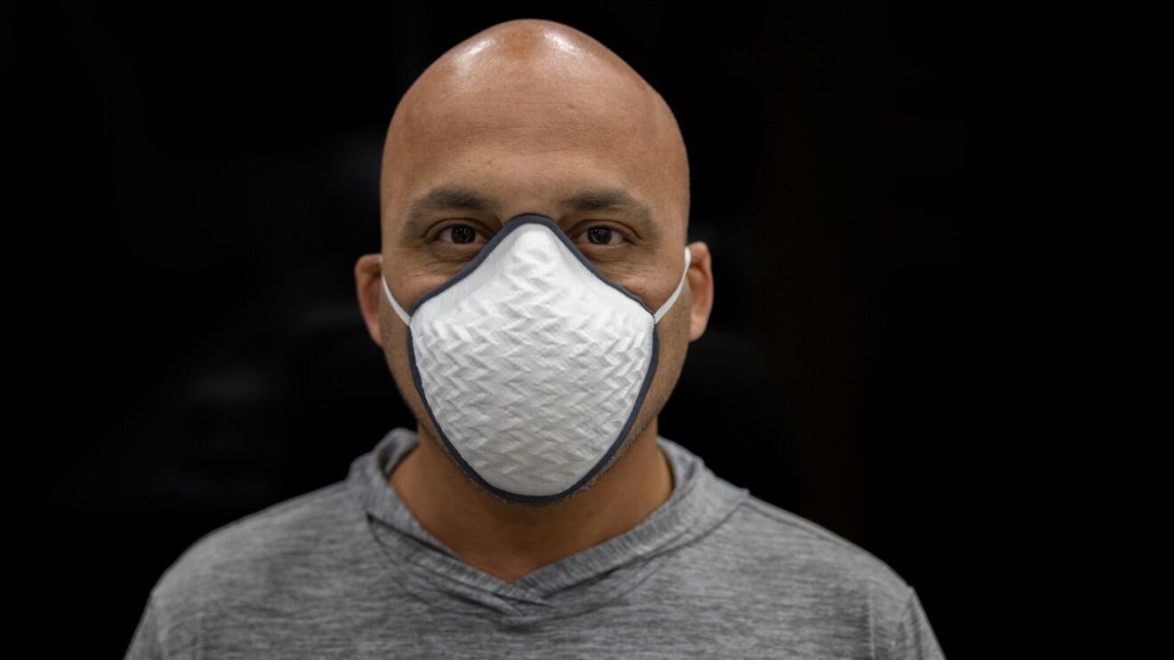 Tushar Mahale wears a face mask.