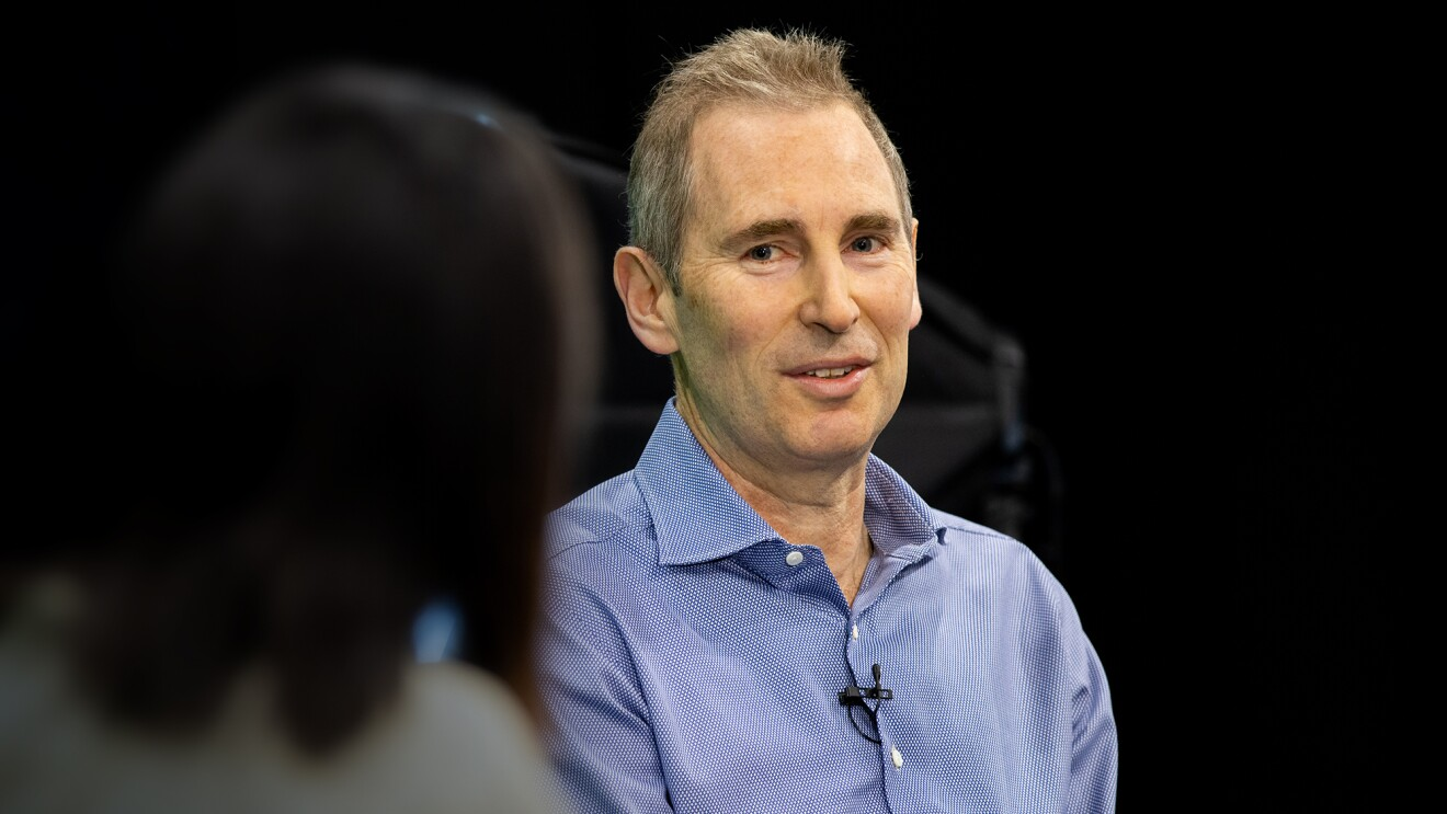 Andy Jassy, CEO of Amazon, speaks with Alicia Boler Davis as he answers employee questions at a fireside chat.