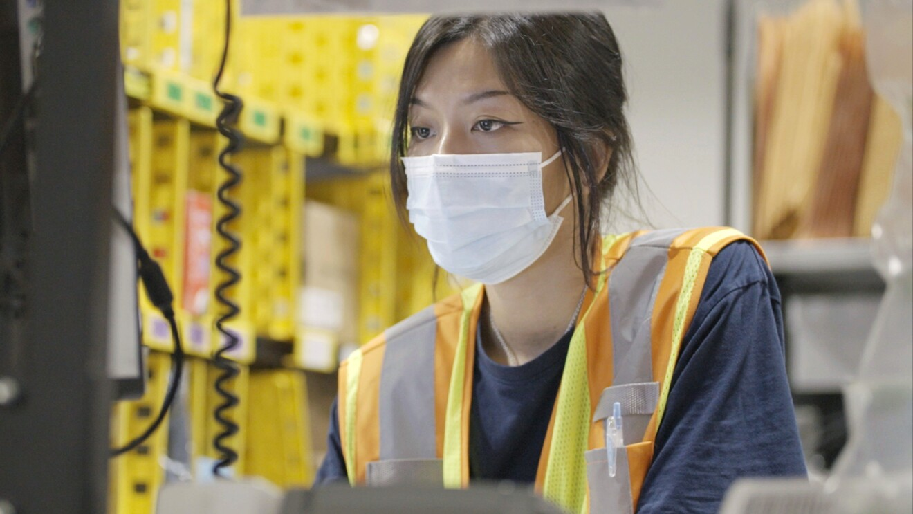 Amazon associate Kathie Koh is seen working at Amazon's Fulfillment Center in Singapore