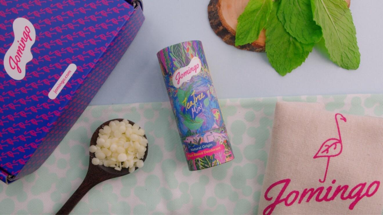 A flat lay of Jomingo's Tea Tree Mint deodorant