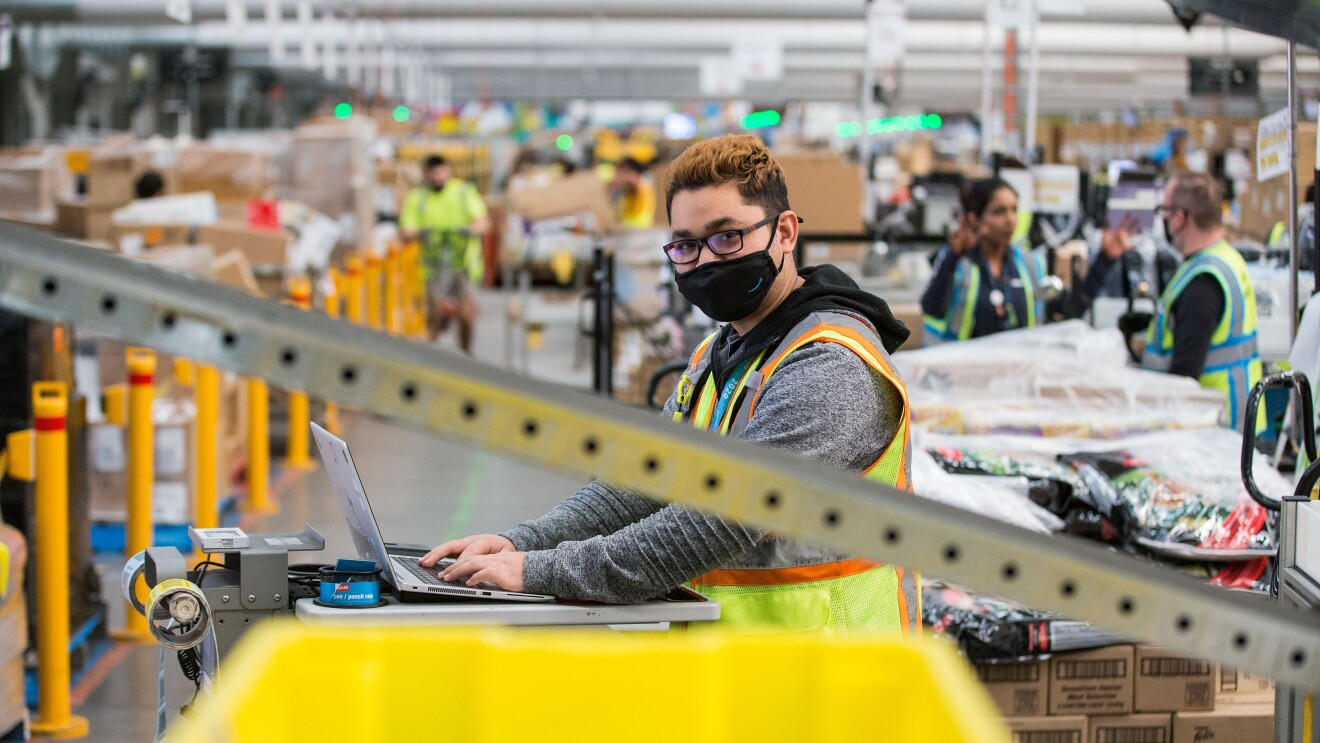 Amazon employee working at a fulfillment center in Australia.