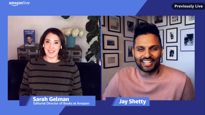 """A split-screen image showing a screenshot from the Amazon Live video where Sarah Gelman interviewed Jay Shetty. You can see Sarah's image on the left of the screen with Jay's book """"Think Like a Monk"""" in the background, and Jay Shetty's image on the right."""