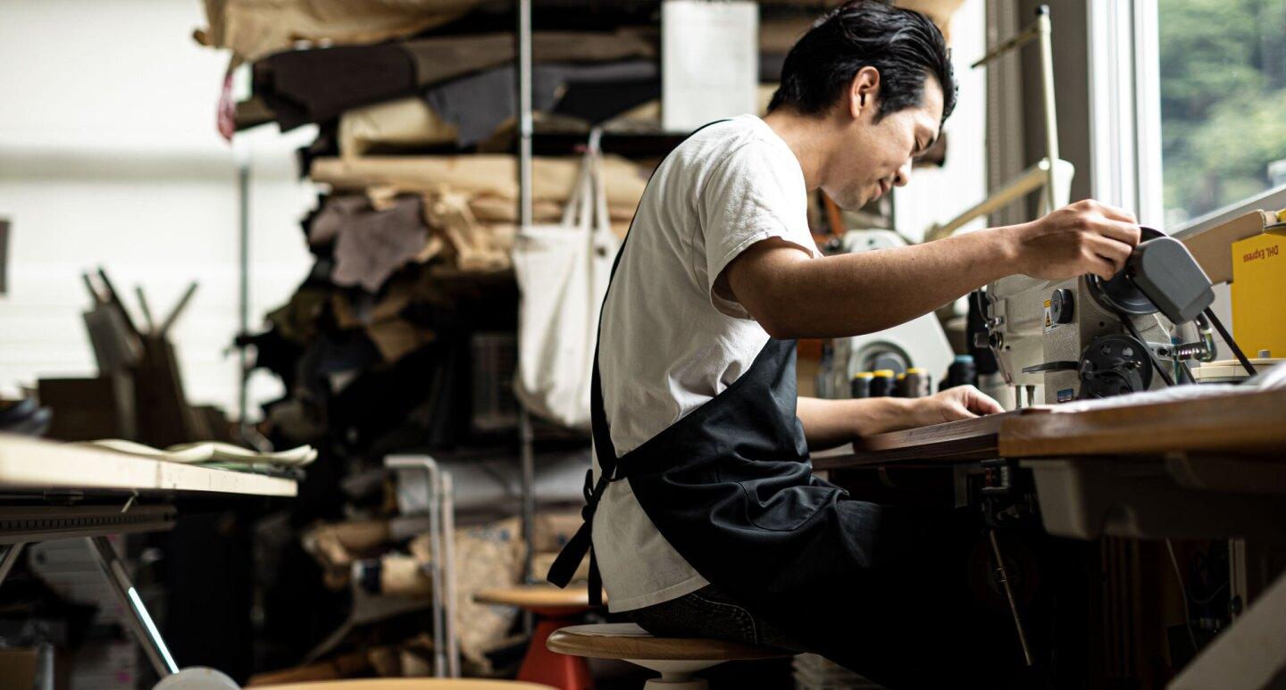 A craftsman works at his station.