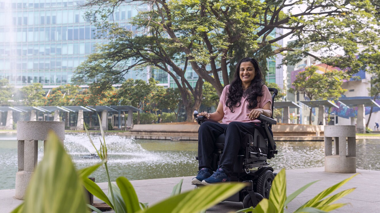 Mrunmaiy Abroal smiles for a photo in front of the Amazon building in Bangalore, India.