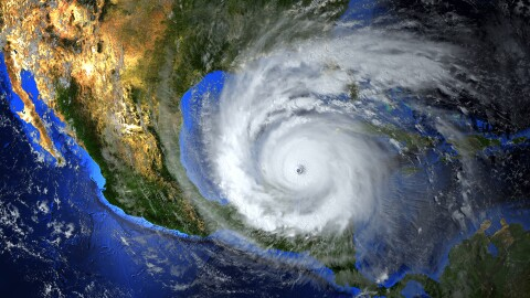 A composite image showing a hurricane approaching the U.S. Gulf Coast